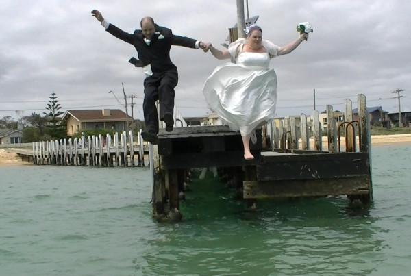 Wedding Couple jump into ocean