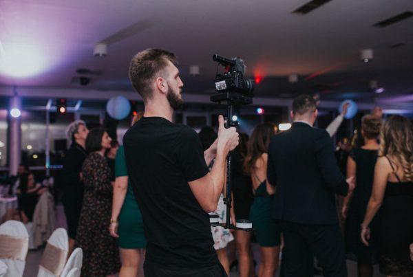 Videographer shooting at wedding
