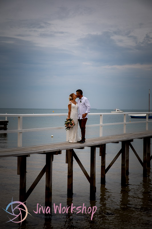 Couple Kissing Pier
