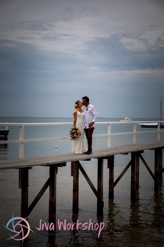 Couple Kissing Pier