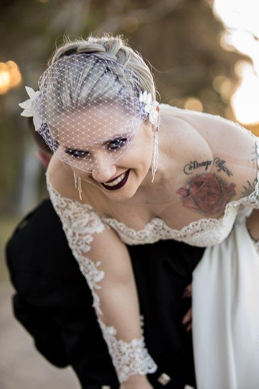 Carrying Bride over shoulder