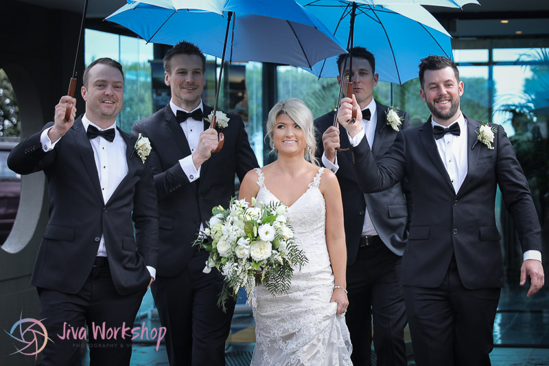 Bride Raining Umbrella's